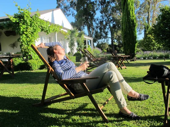 Doing what I do best, falling asleep in the sun with a glass of wine in hand. Hans Herzog.